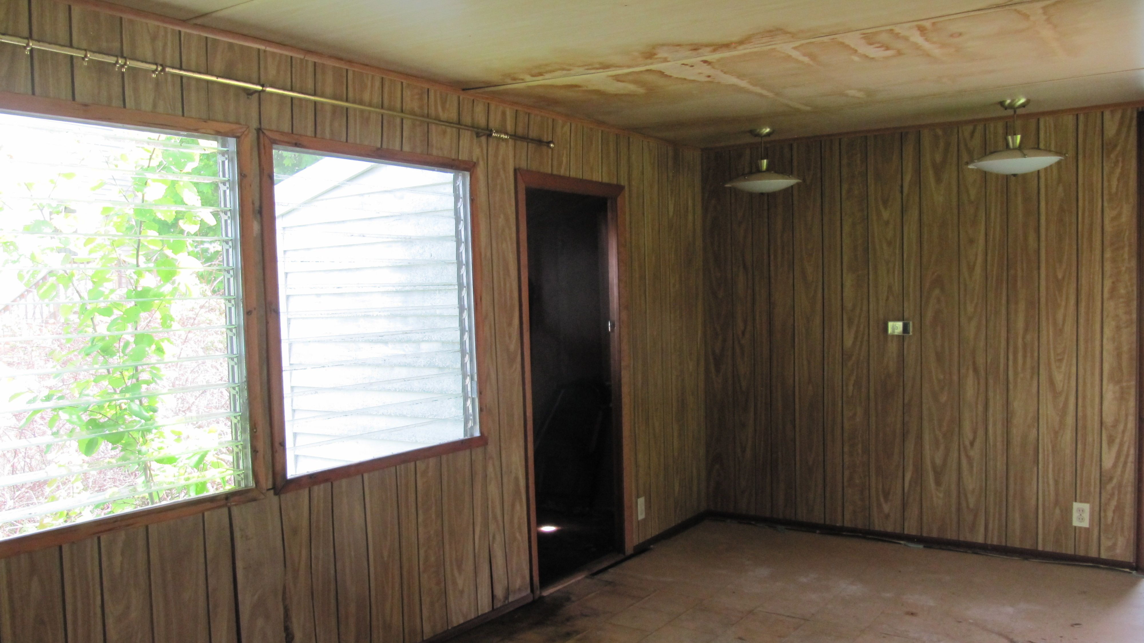 Main Living Area In A Word Disgusting Dark Paneling Water Damage And A Warped Door Living Area Home Cottage