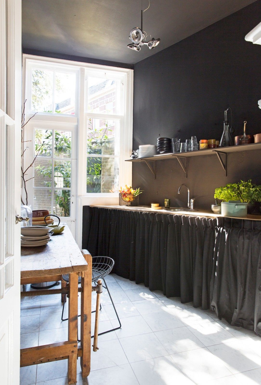 dark kitchen, love the curtains instead of low cupboards