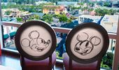 Two chairs near the picture window overlooking the Theme Park.