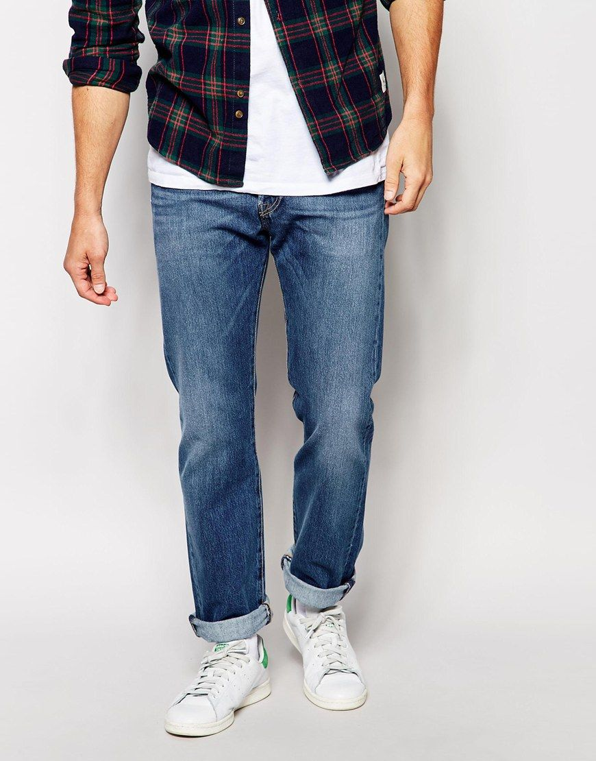 """Jeans by Levi's Non-stretch denim Mid-wash Regular rise Button fly Straight leg Straight fit - cut with a straight leg Machine wash 96% Cotton, 4% Polyethylene Our model wears a 81cm/32"""" regular and is 185.5cm/6'1"""" tall"""