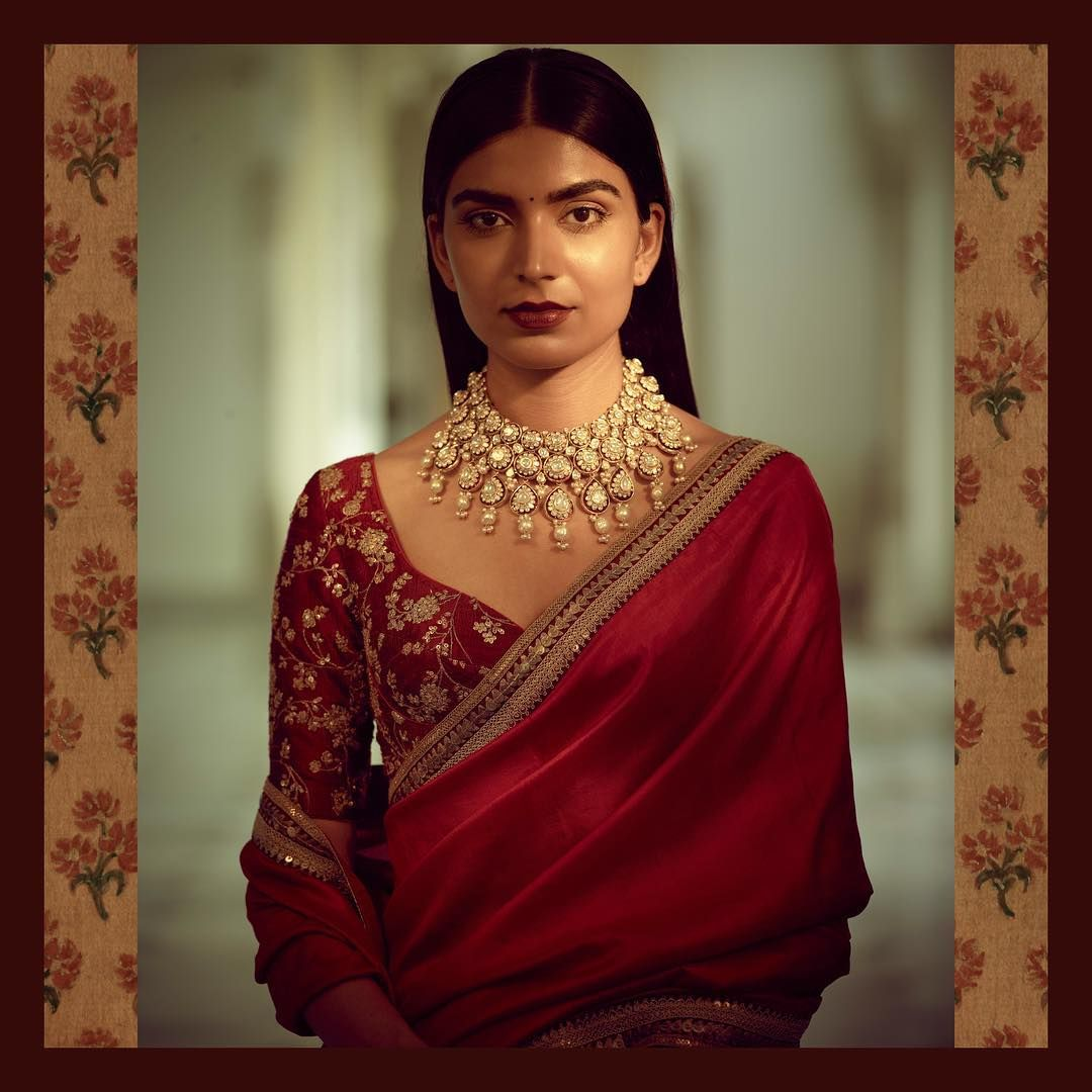 5004fc10a72f88 A classic Sabyasachi silk saree in red with hand-embroidered border and  blouse paired with a statement necklace crafted in 18k gold with uncut  diamonds and ...
