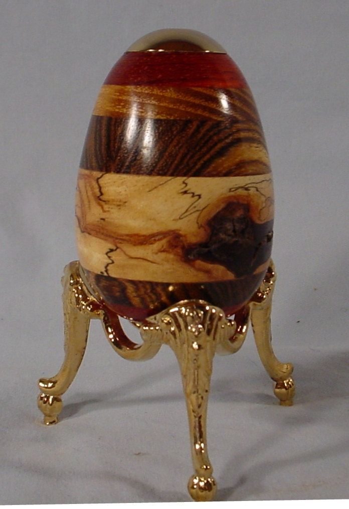 Exotic Wood Layers in a 24k Kaleidoscope Egg with brass stand By Bryan Tyler Nelson.  via Etsy.