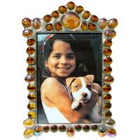 A mix of small and medium jewels adorn one large chunky jewel for a crown-like look in this stately Marquee frame. Various colors and sizes available at fusionartglass.com.