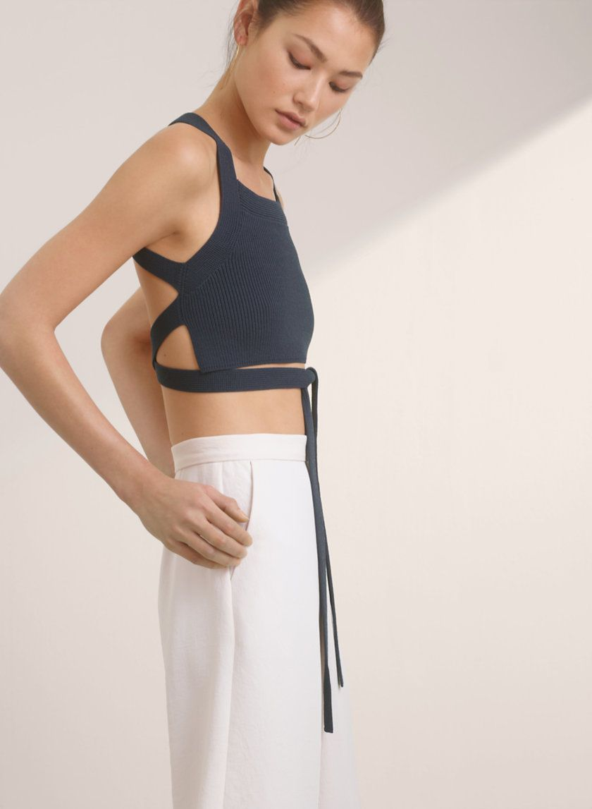 5554577d43eff3 The Cayenne is a cropped, open-back tank top with ties that work in the  front or back. It's knit with a super-fine rayon blend that's slinky with a  cool, ...