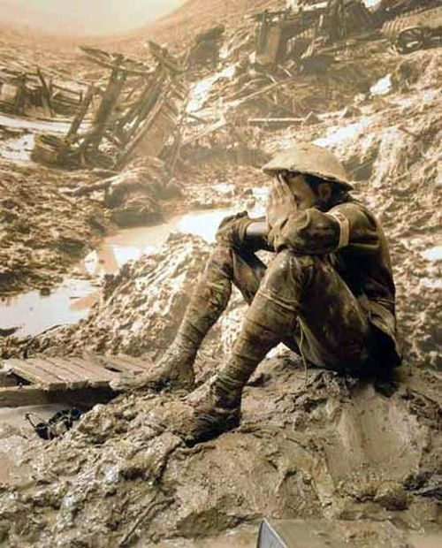 Soldier sitting in the mud and ruins of battle. He's had all he can take.