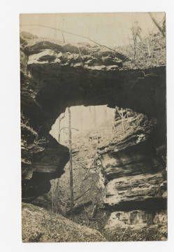 Man on top of natural bridge made of rock near Monticello in Wayne County Kentucky. :: Ronald Morgan Postcard Collection