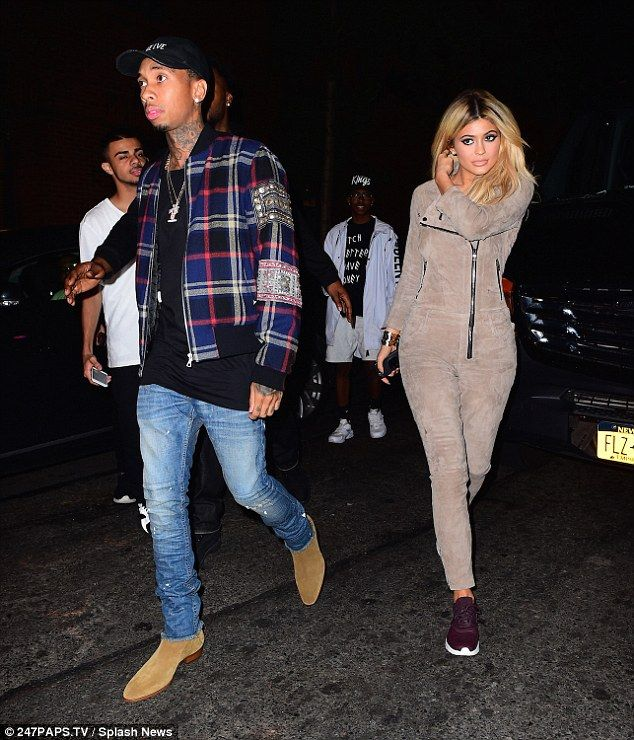 Daring: But the youngest of the bunch, 18-year-old Kylie, showed her fashion edge in a jumpsuit and purple trainers while walking with her beau Tyga