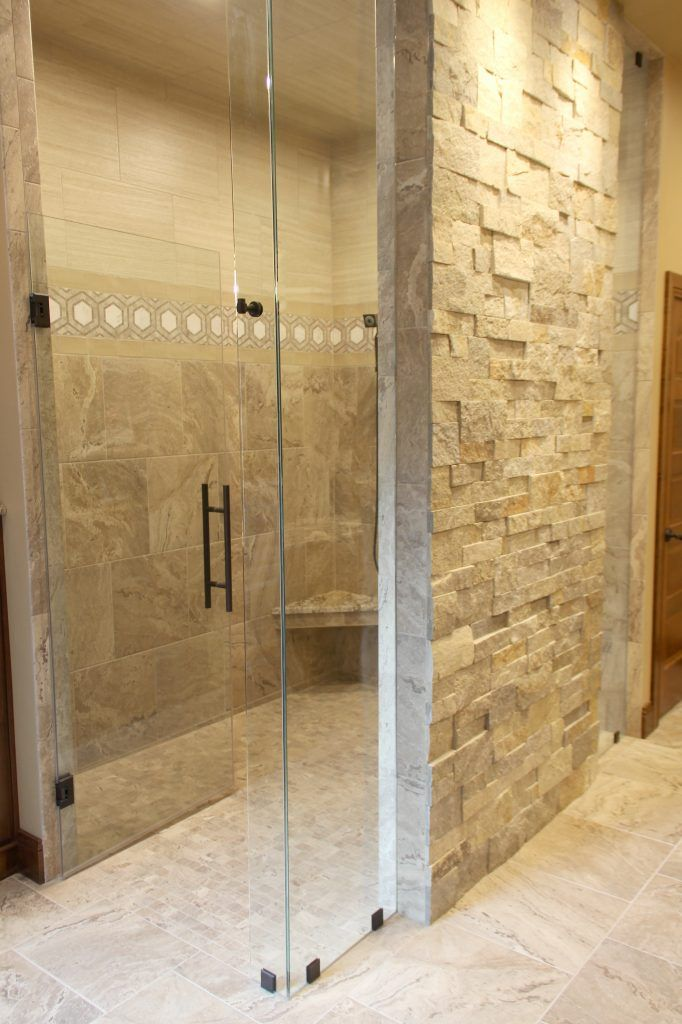 Tan And Beige Shower Tile With Natural Stone Tile, Clear Glass Shower Door  With Black Hardware