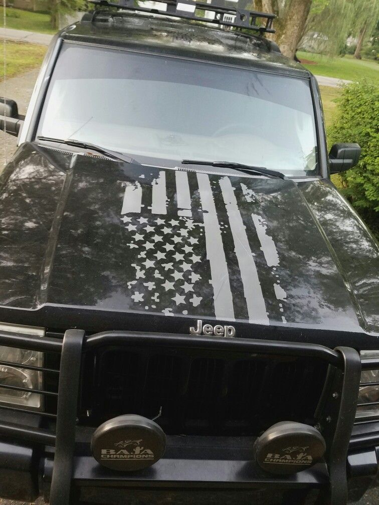 My new Tactical Gear Tattered Flag Hood Decal on my Jeep Commander