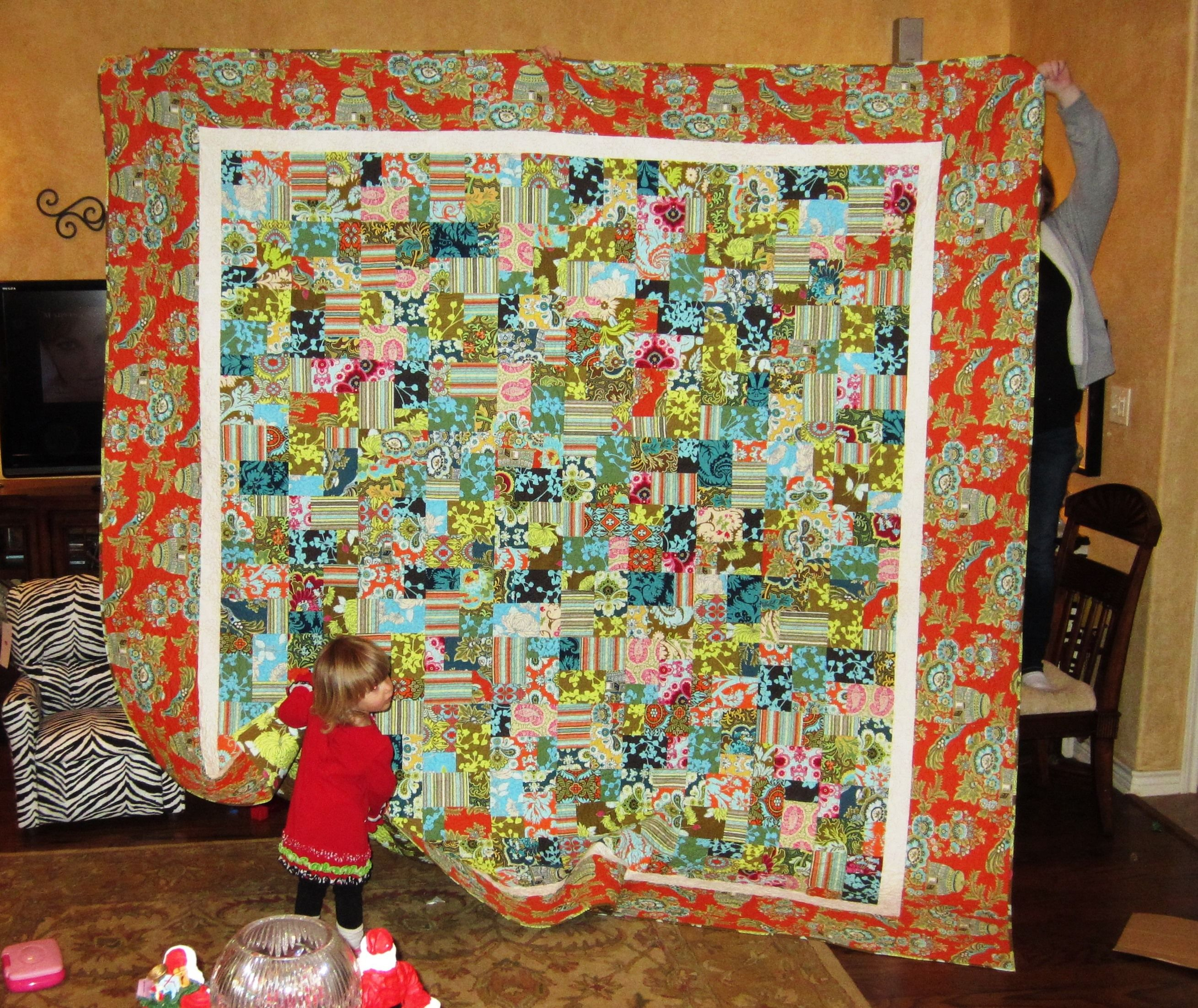 King size double slice layer cake quilt I made using fabrics from the Belle line by Amy Butler.