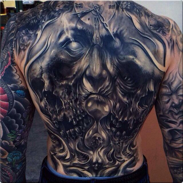 Great black bear with trees tattoo idea on the sleeve
