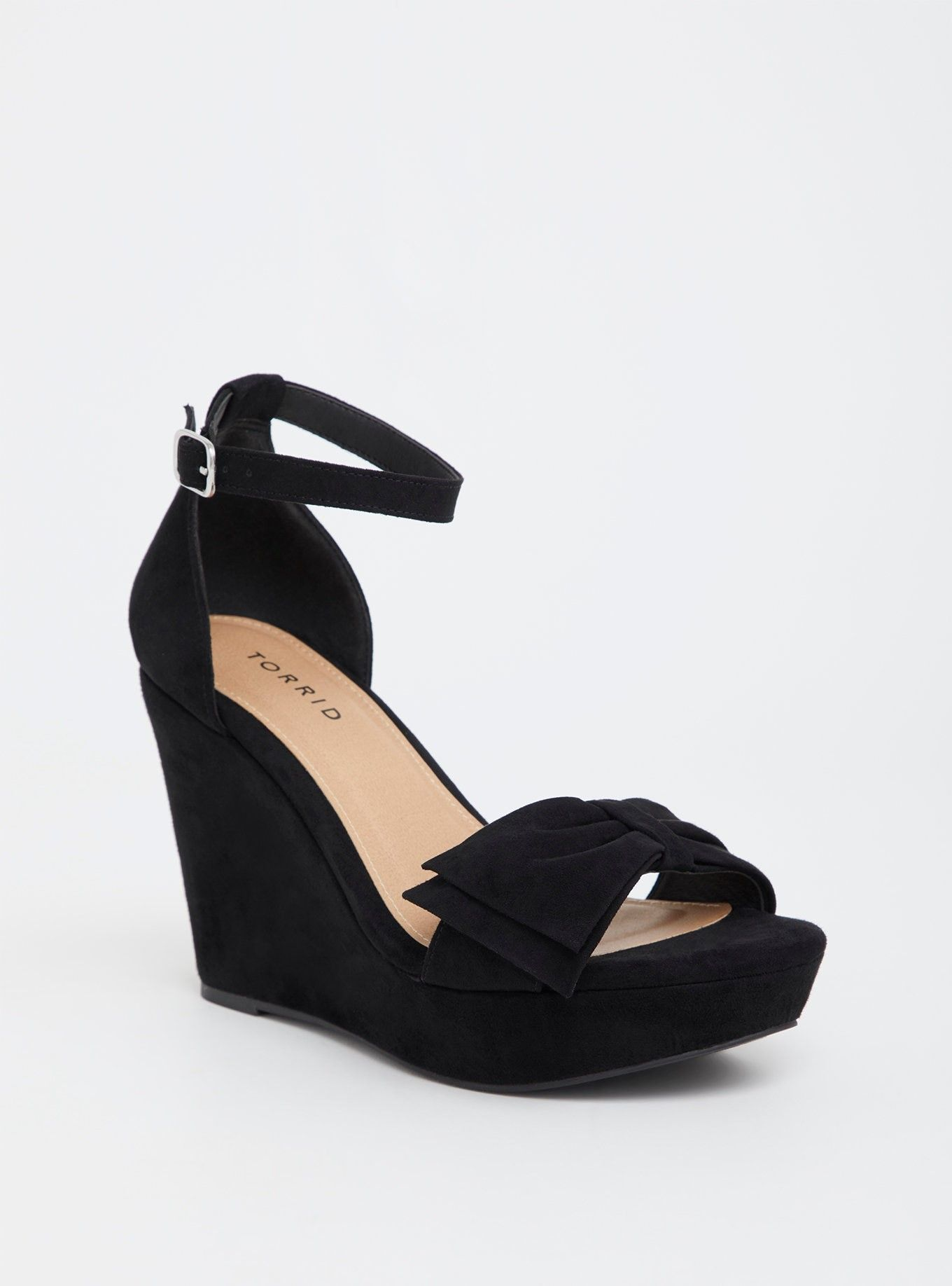 1481e779484 Black Faux Suede Bow Wedge Sandal (Wide Width) - Soft faux suede has a luxe  finish on a wedge platform sandal that has a girlie bow toe strap.