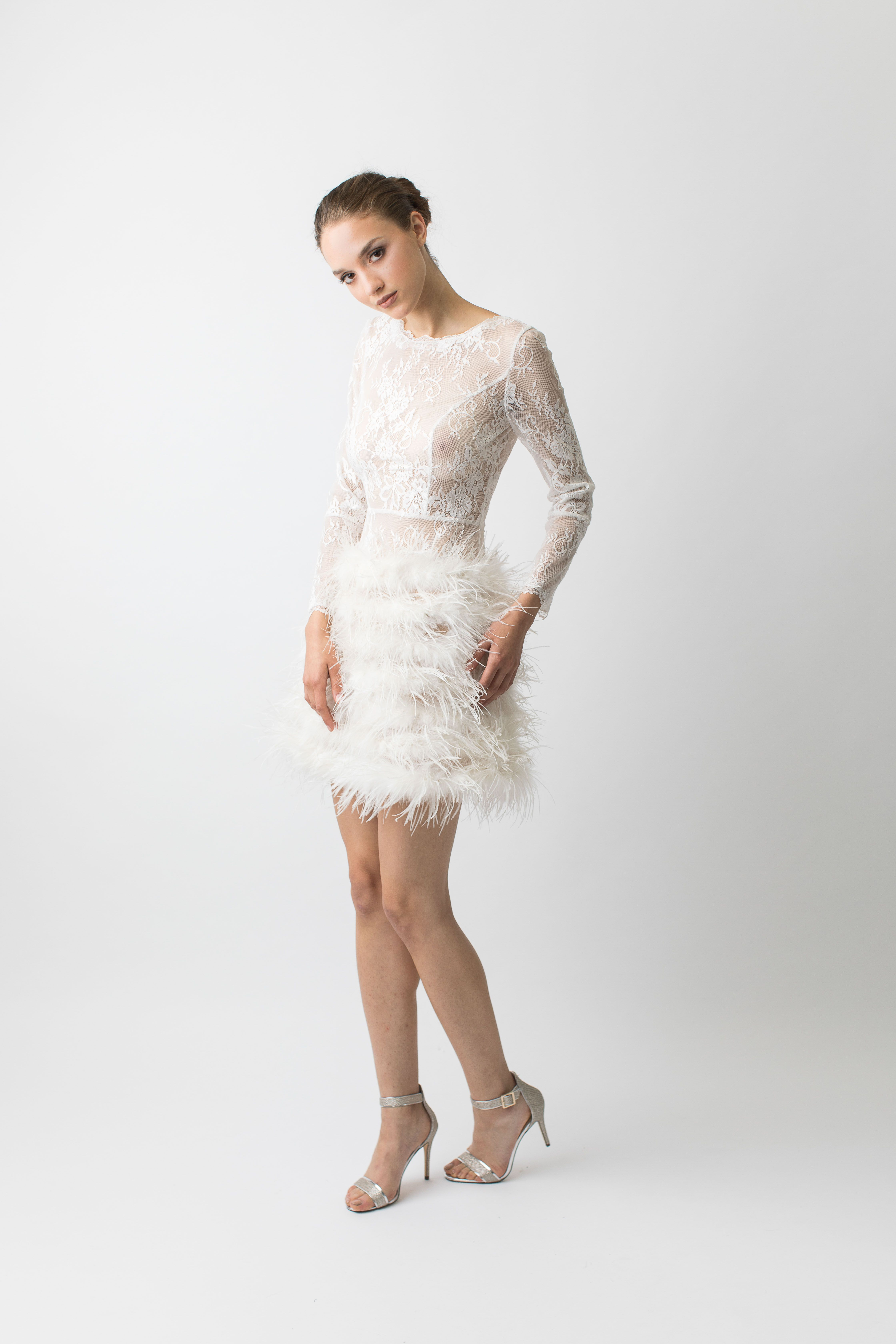 ca8915ef193 White sheer lace long sleeve feathered dress. This mini dress is the epitome  of fun