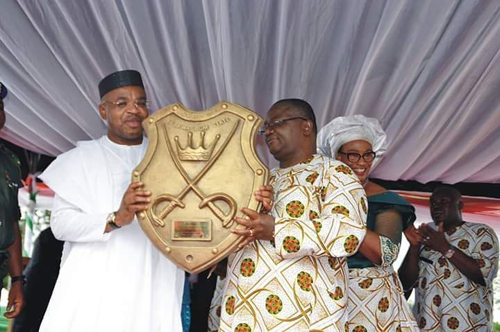 Governor Udom Emmanuel of Akwa Ibom State (left) receiving an Award of Commander of Akwa Ibom State from former Senator of the Federal Republic of Nigeria Senator Effiong Bob during a grand reception in his honour by the people of Nsit Ubium Local Government Area.