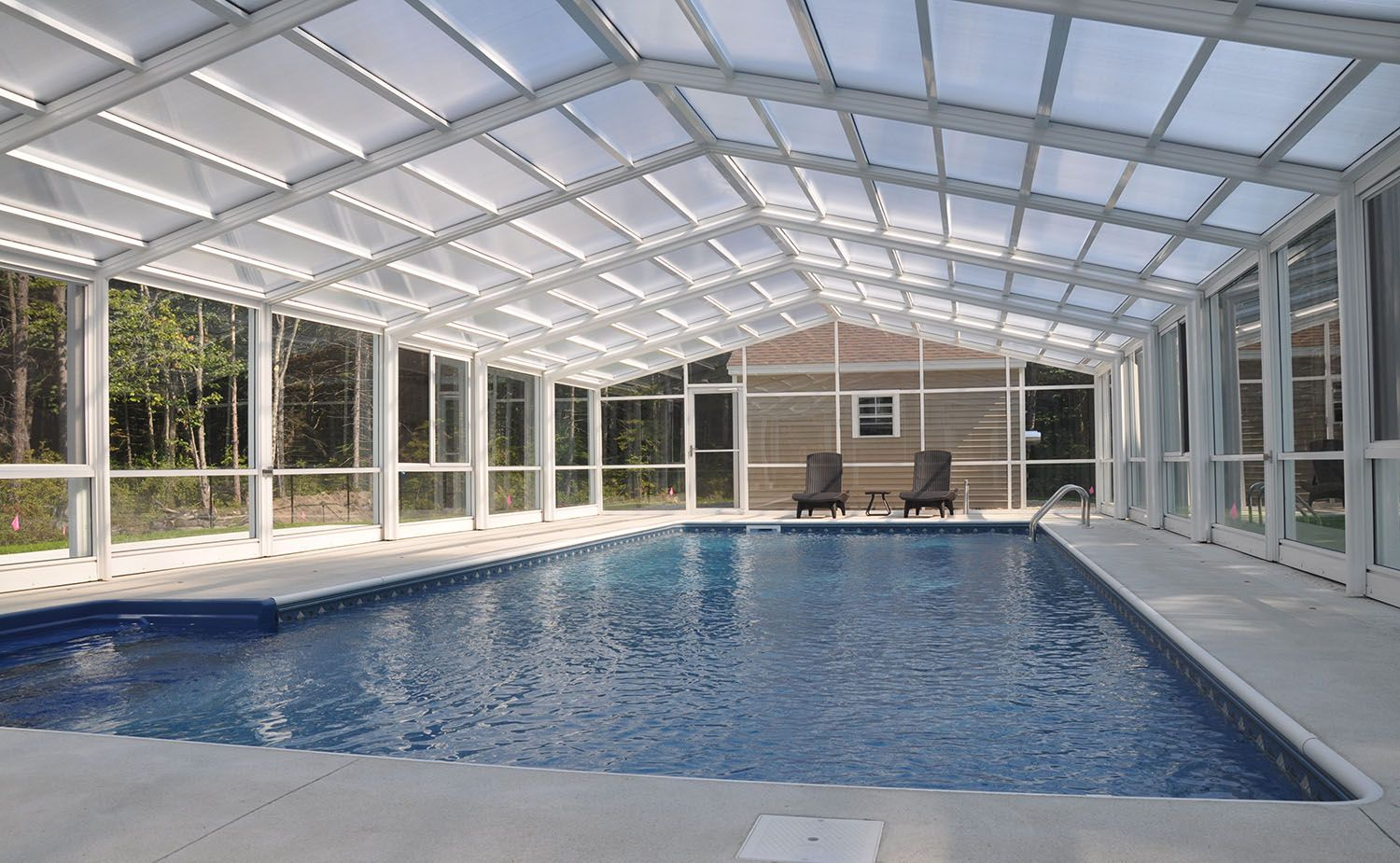 Maine Pool Enclosure Manufactured By Roll A Cover Creates A Year Round Swimming Experience Retractable So Pool Enclosures Endless Pool Backyard Pool Designs