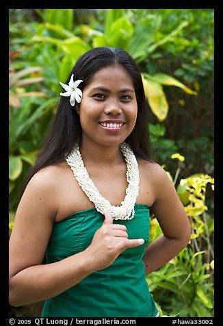 Tahitian woman making the traditional welcome gesture. Polynesian ...