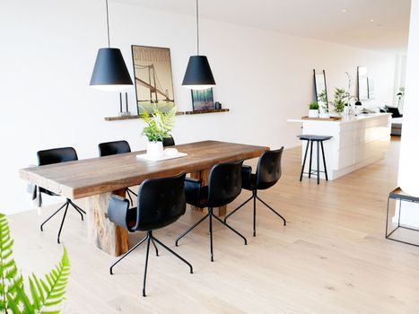 Primum Chairs around a rustic dining table from by Løth. A Nordic ...