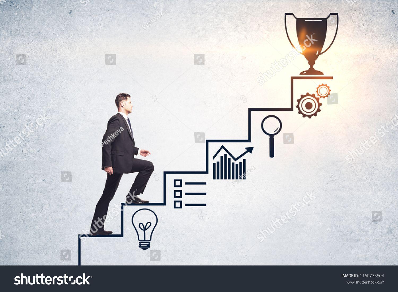 Businessman Climbing Creative Steps And Award Sketch On Concrete