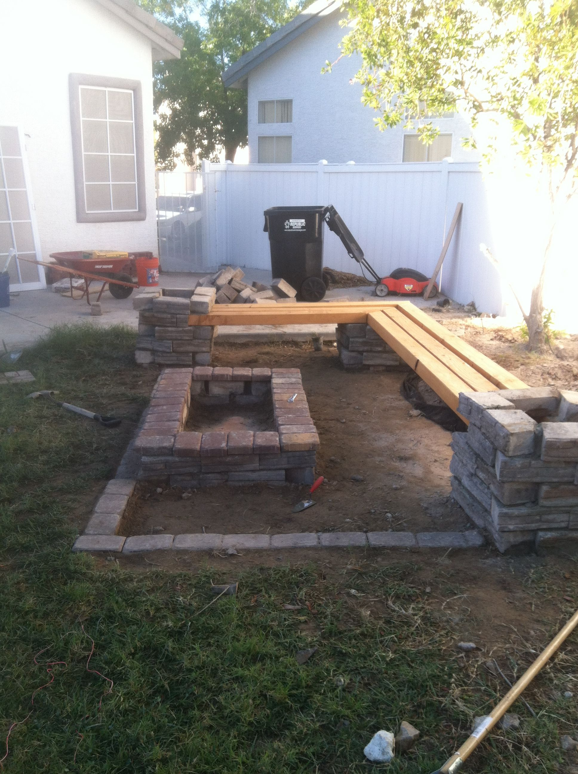 brick fire pit with wood beam seats | Projects for my man ...