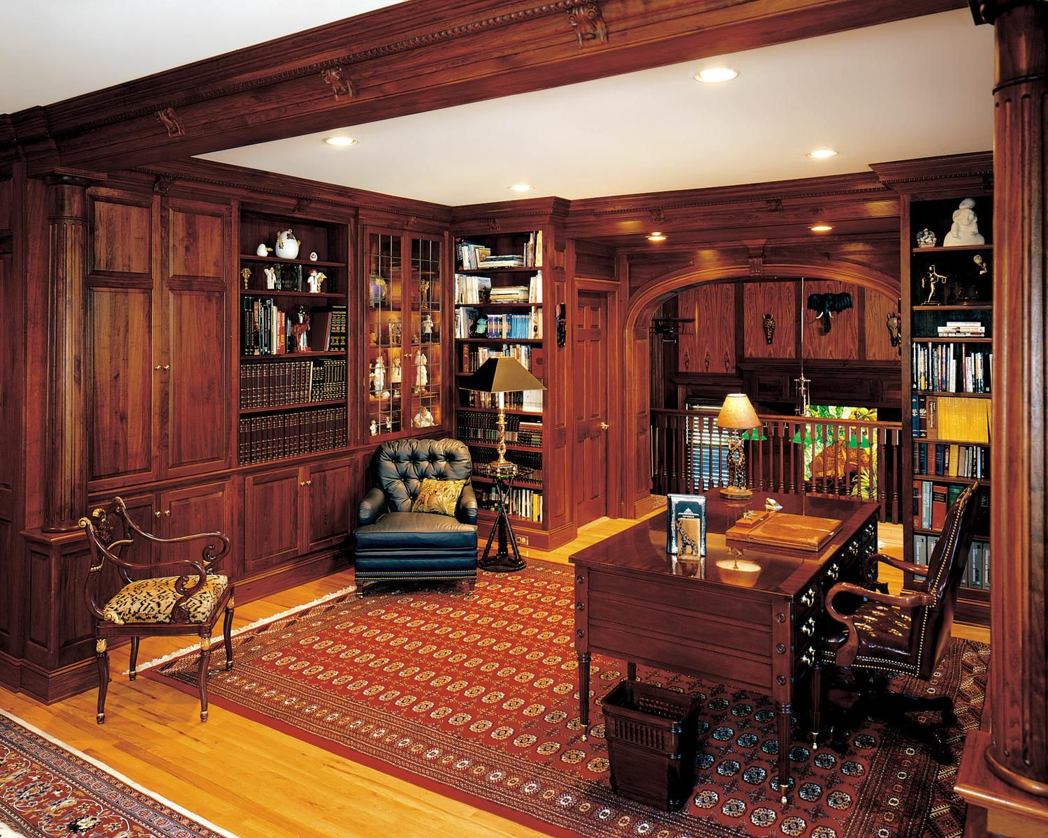 Walnut library with fireplace and gun cabinets products for Home gun room