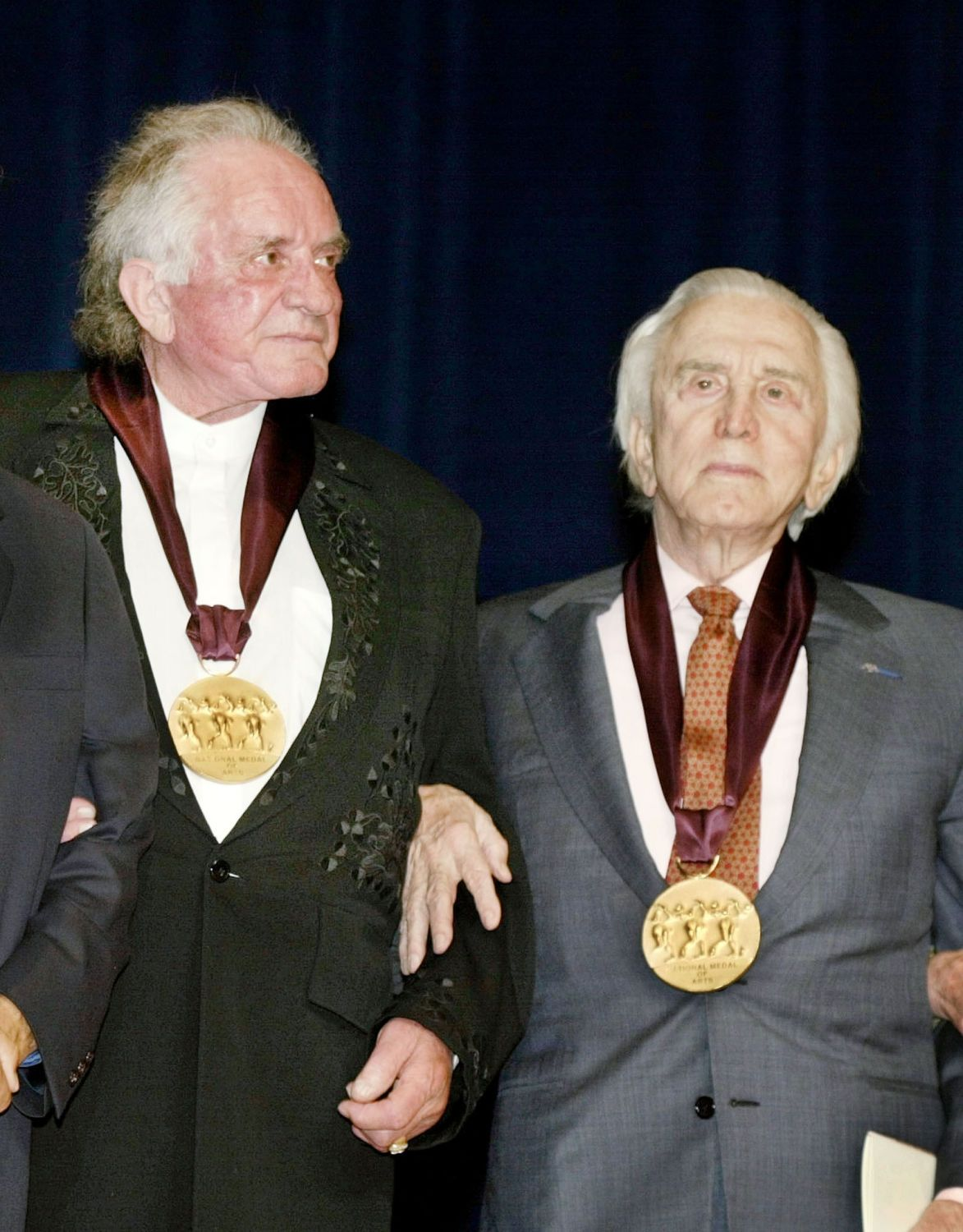 Johnny Cash Photo Gallery: Both Johnny Cash and former costar Kirk Douglas recieved the National Medal of the Arts on April 22, 2002 from President George W. Bush. (Photo:  Reuters/CORBIS)