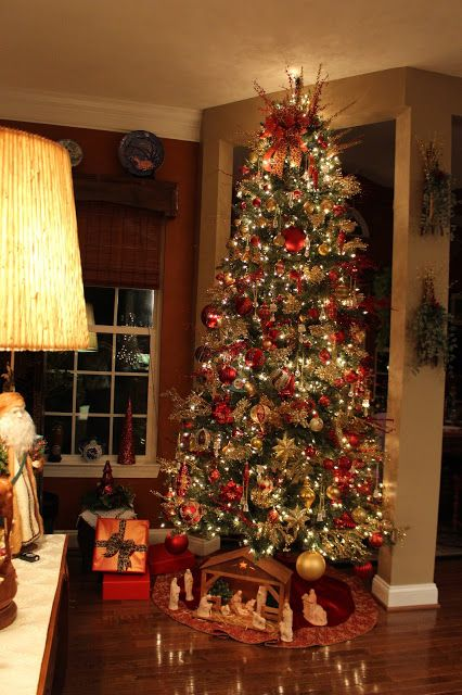 gorgeous 10 foot christmas tree all red and gold with a touch of animal print designs by pinky oh christmas tree - How To Decorate A 10 Foot Christmas Tree