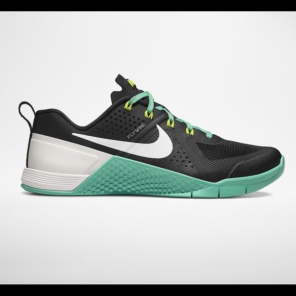 Nike Metcon Nike women's metcon shoe. Black and turquoise. Only worn once.  Super