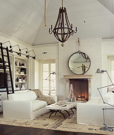 I like the rustic industrial style of these lamps and chandeliers in this living space.