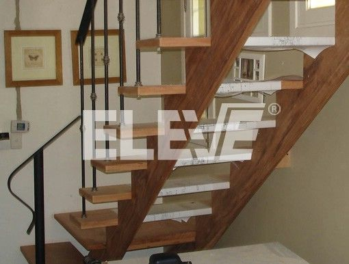 Escalera estructural en madera de dise o moderno barandas for Como construir una escalera de hierro y madera