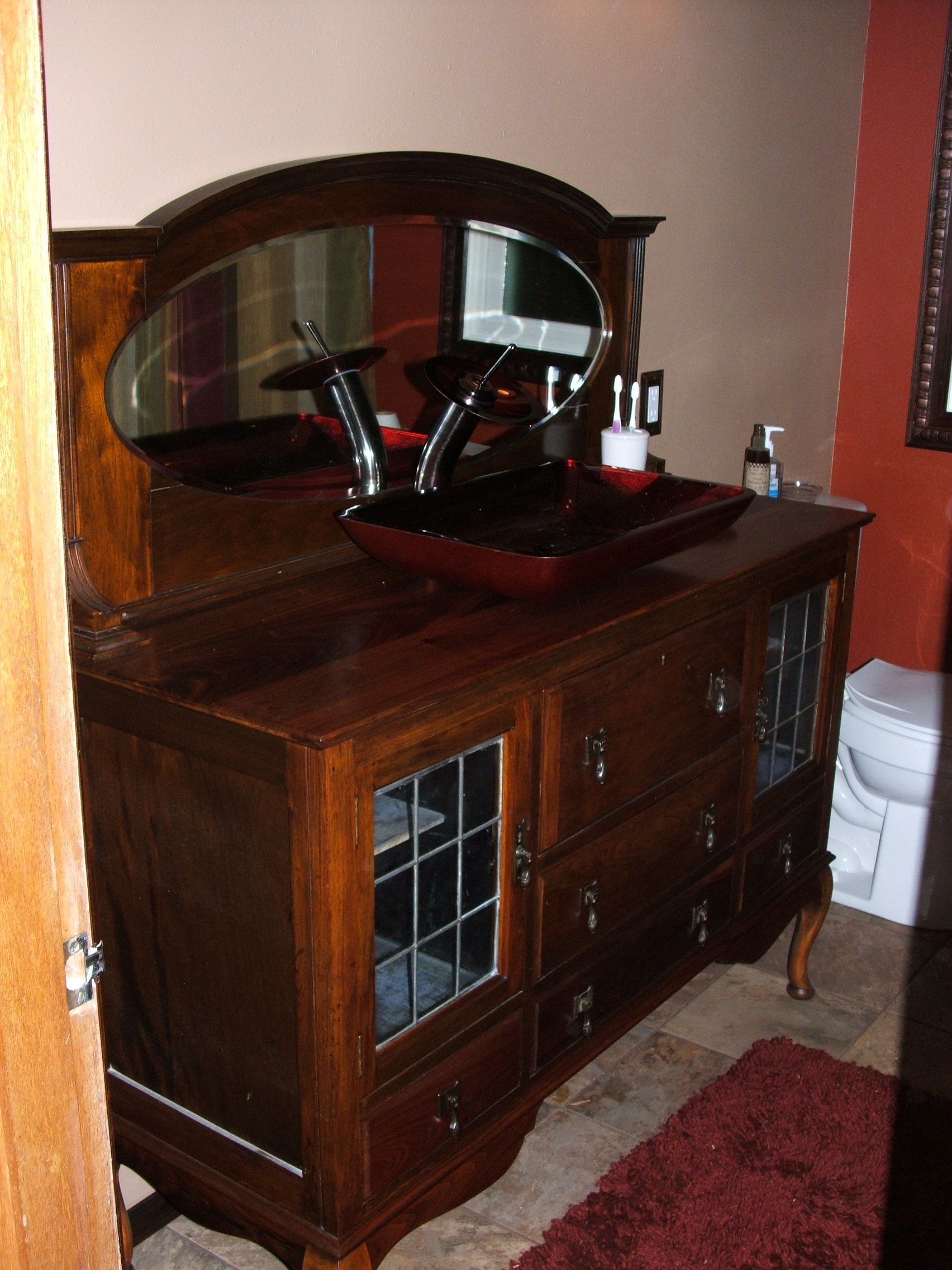 Antique buffet my husband refinished and made into a vanity.