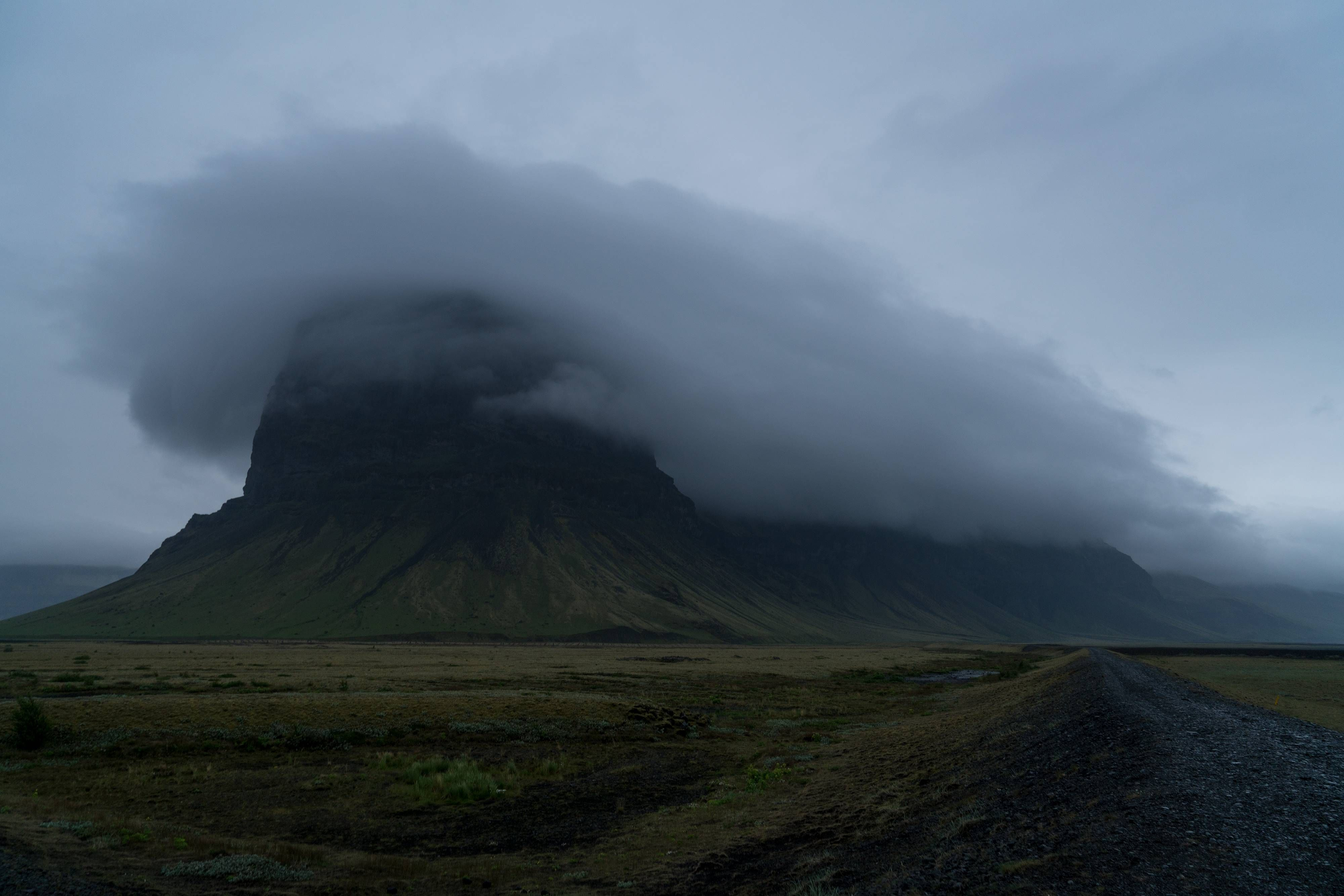 Came across this amazing cloud cover over a mountain during a storm. Þjóðvegur Iceland. [OC][40002668] #reddit