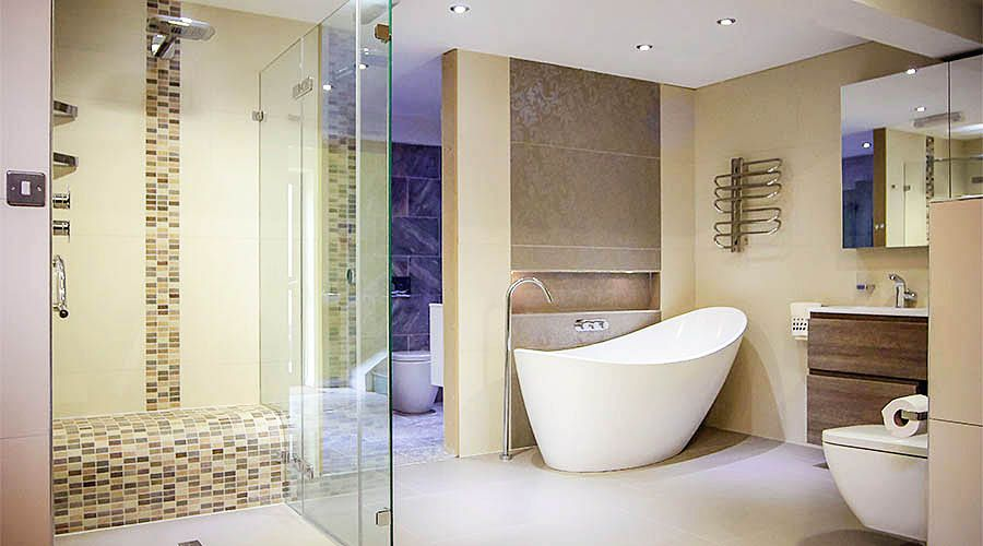 Luxury frameless glass shower enclosure and bathroom displays at the
