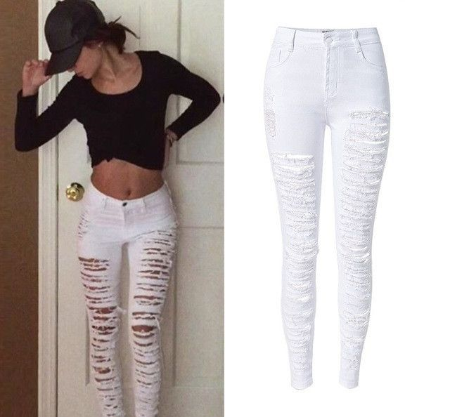 Plus size black skinny jeans with rips