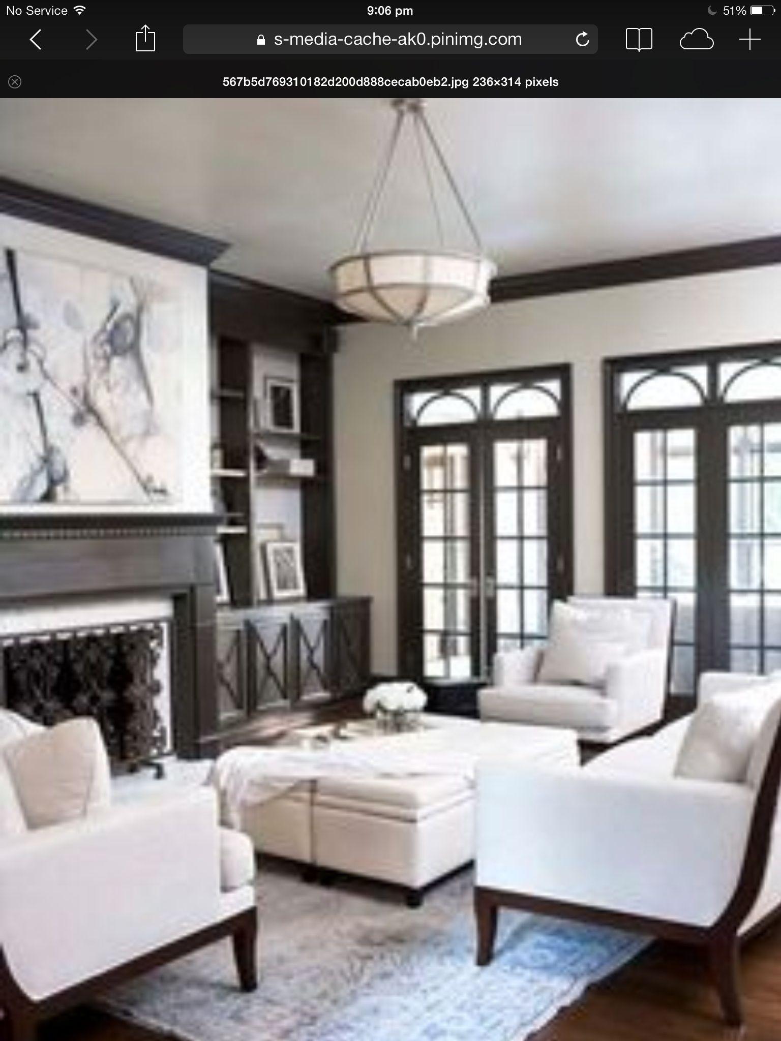 taupe walls black windows dark wood flooring | stylishhome