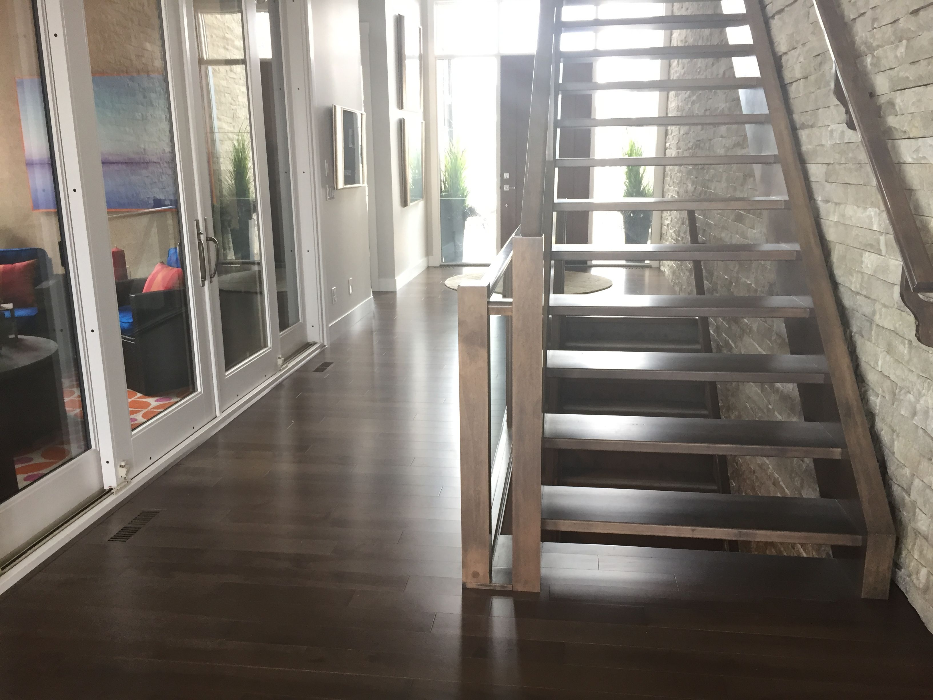 Beautiful entry from the Cantata Showhome featuring Lauzon's Smokey Grey Hard Maple hardwood flooring from the Essential Collection. Project realized by Baywest Homes in the Rocky View County (Springbank) Harmony collection. #interiordesign #hardwoodfloor #artfromnature @baywesthomes