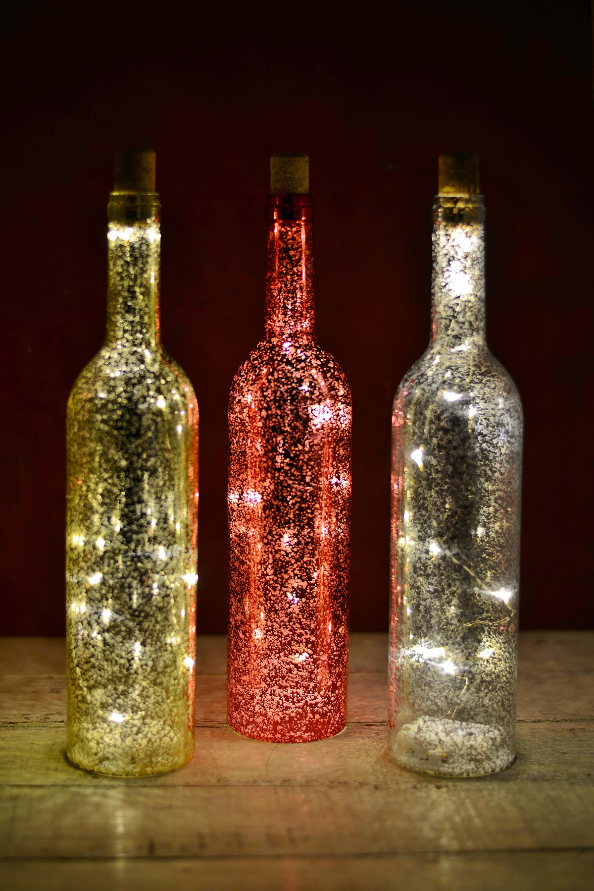 Christmas decorations mercury glass glass bottle and bottle for Glass bottles with lights in them
