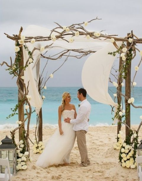 03 driftwood wedding arch decorated with white fabric and flowers 03 driftwood wedding arch decorated with white fabric and flowers for a beach wedding weddingomania junglespirit Image collections