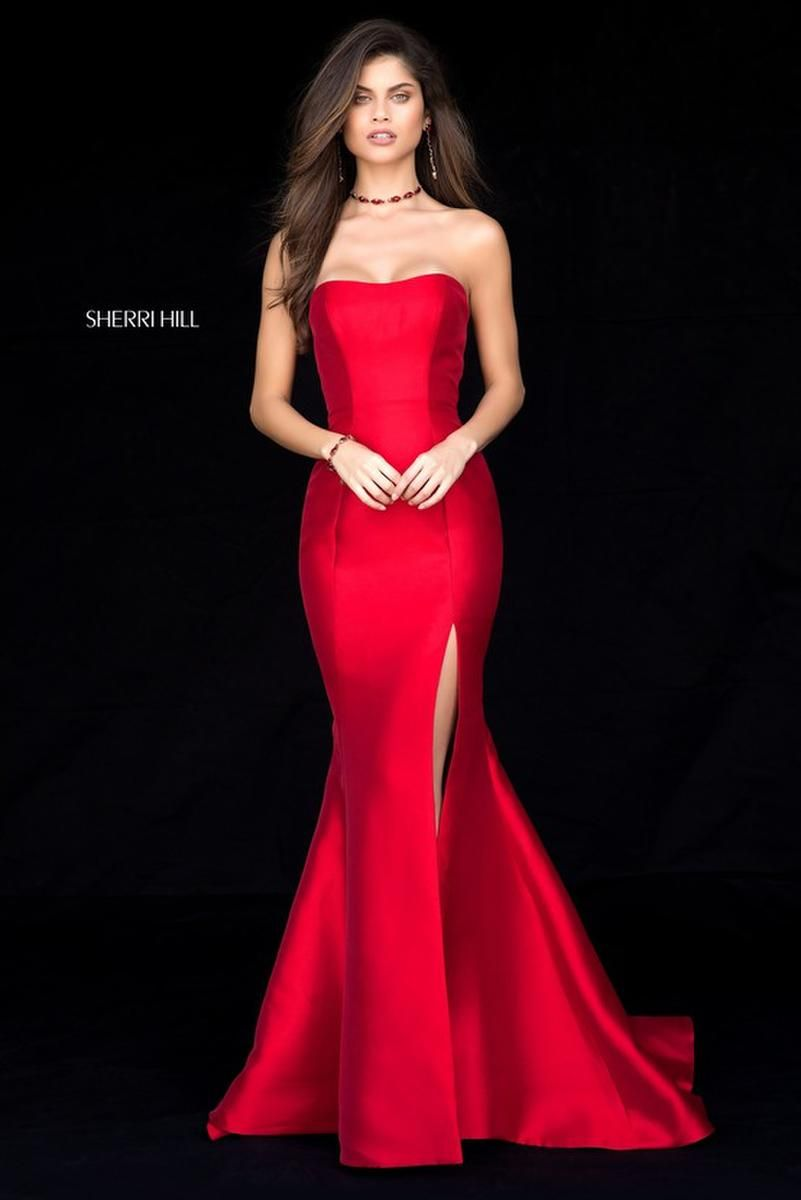 01fe89cfc3 Style 51671 from Sherri Hill is a strapless fitted trumpet gown with a high  skirt slit.