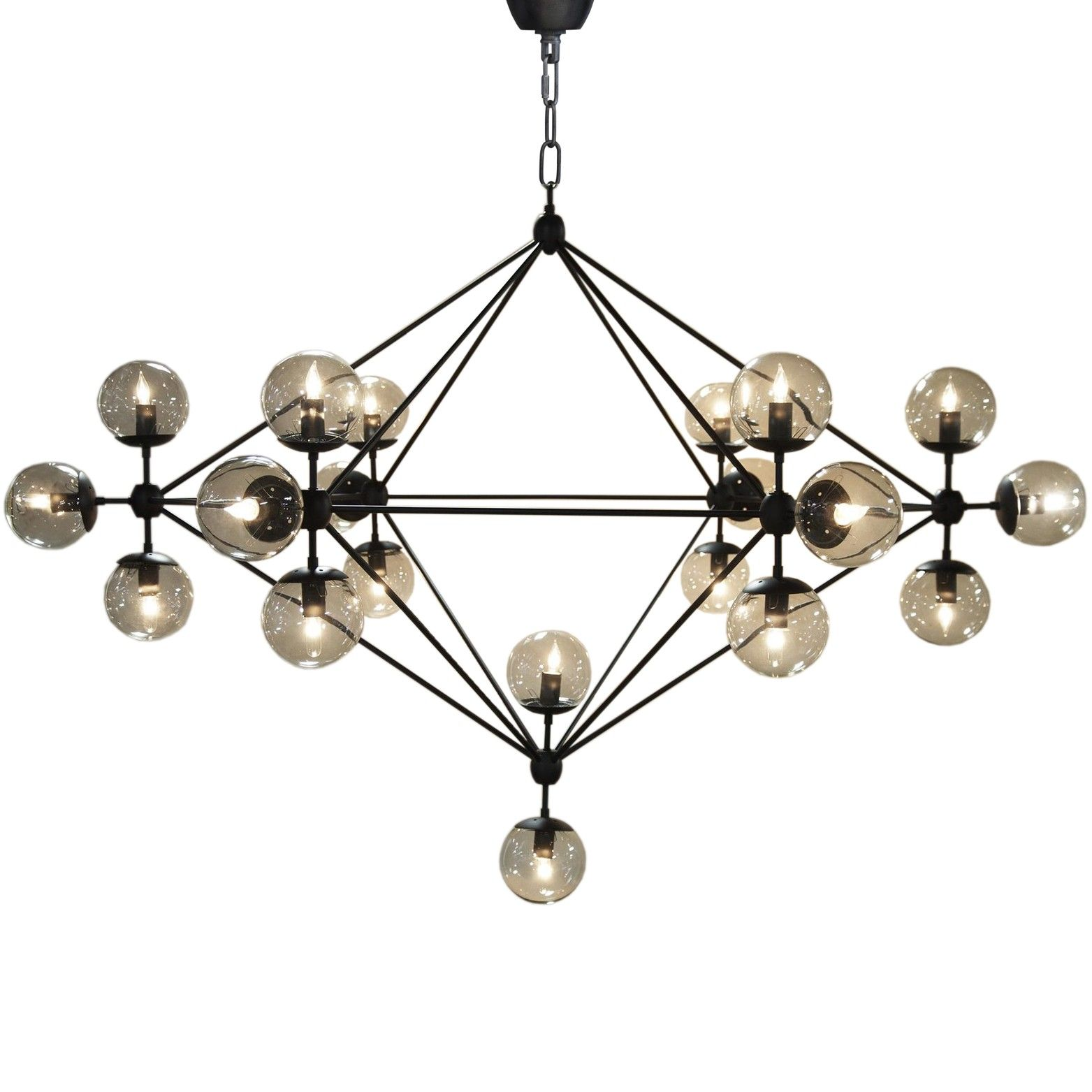 The Pluto Chandelier by Noir emphasizes natural simple and