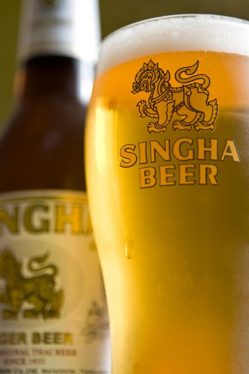 Icy cold glass of Singha beer. Thailands local beers ...