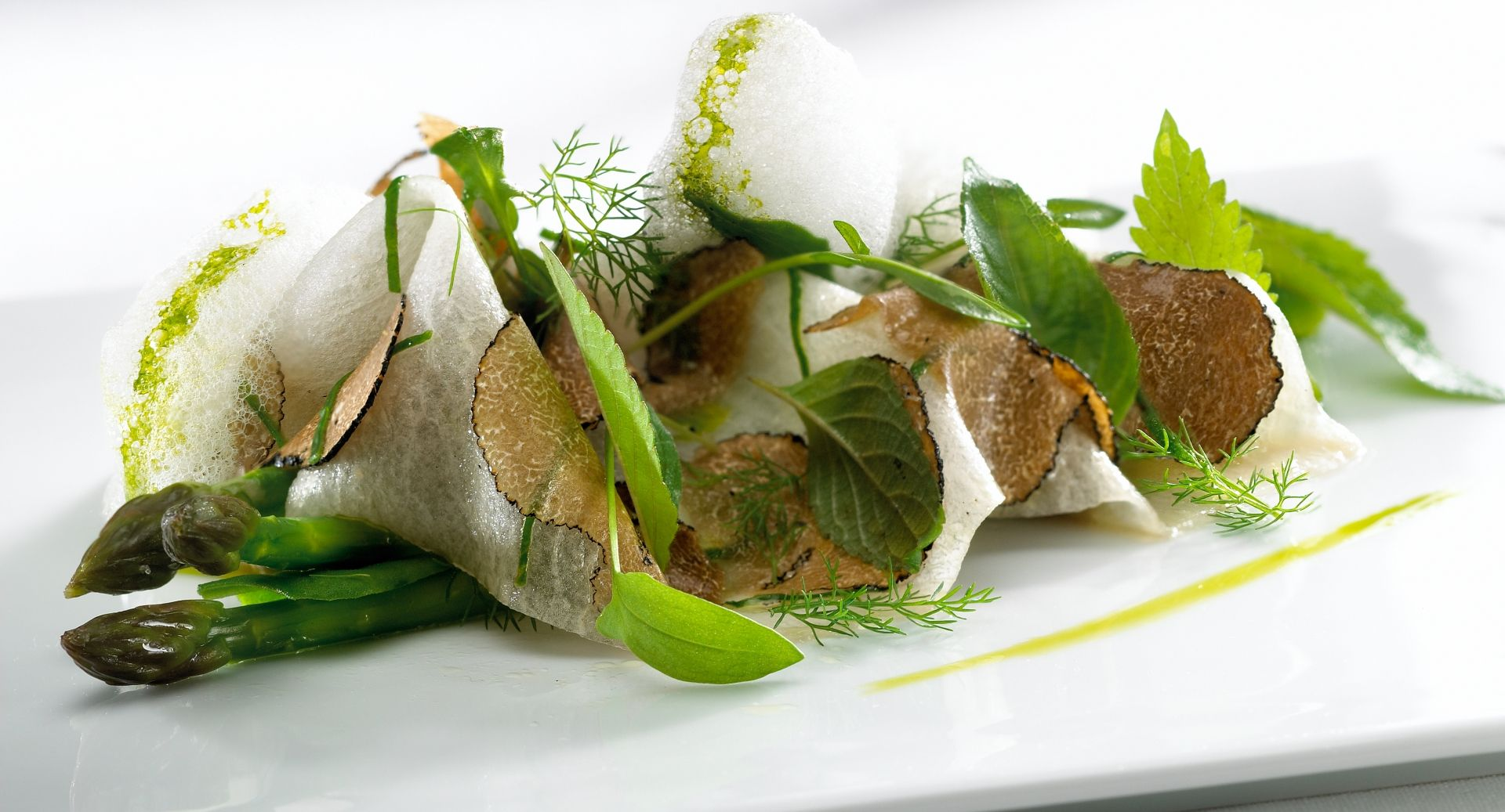 Asparagus, shaved black truffle, white lotus, coconut foam.