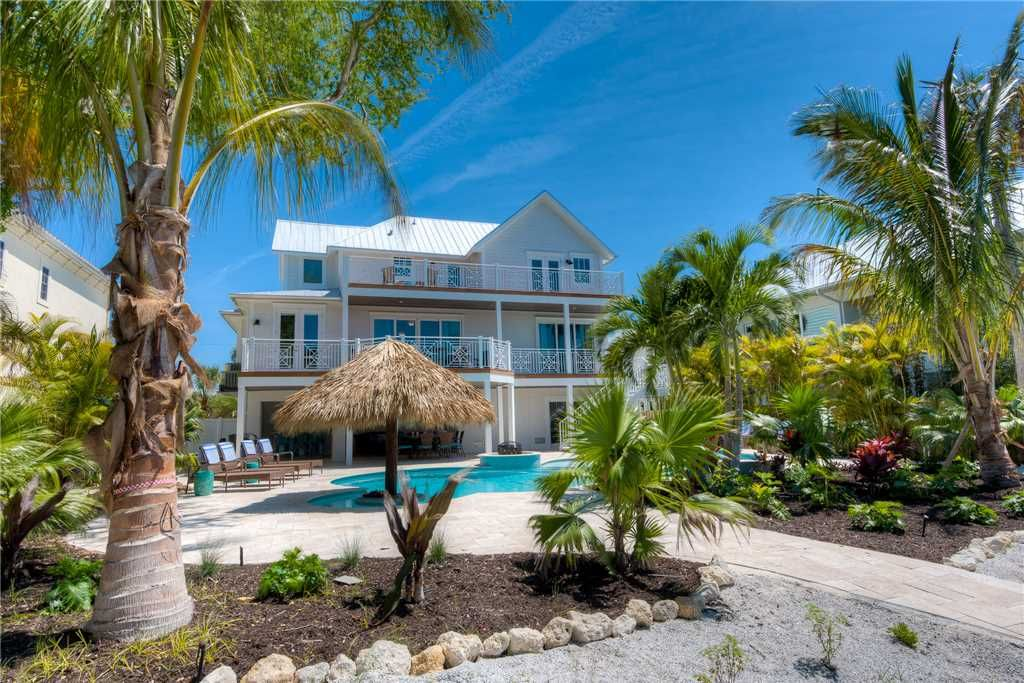 Serenity Beach Is A Beautiful 5 Bedroom Plus A Den And 4 5 Bathroom Rental Home On The Prestigious Northern E Island Vacation Rentals House Rental Fl Vacations