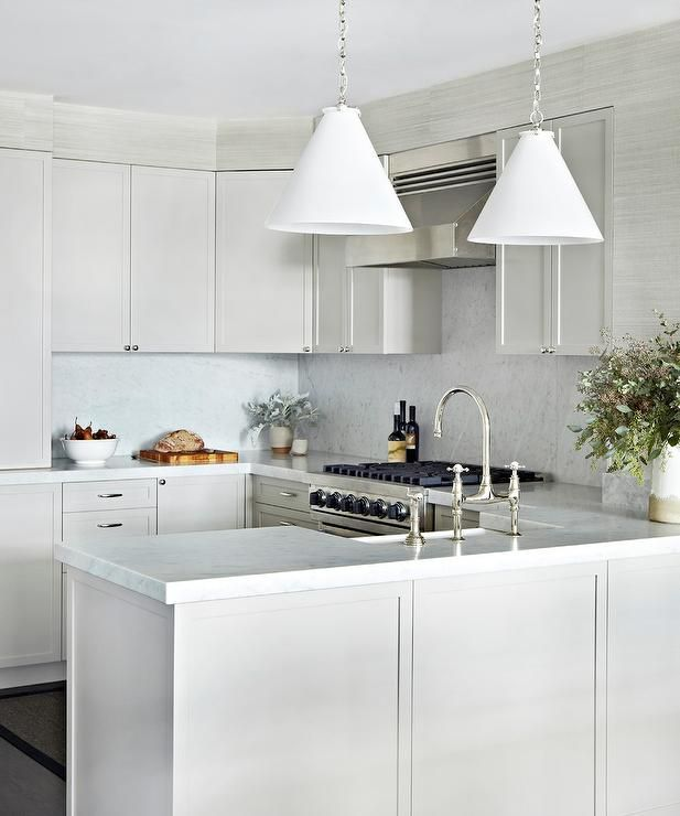 Gray Kitchen Cabinets Marble Countertops: White And Gray Kitchen Features Gray Shaker Cabinets Paired With Carrera Marble Countertops And