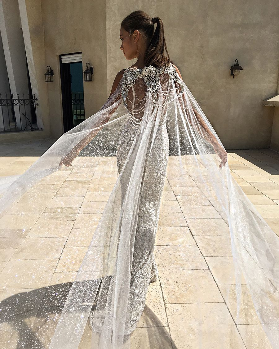 A luxuriously flowy sheer wedding cape for added extra dramatic