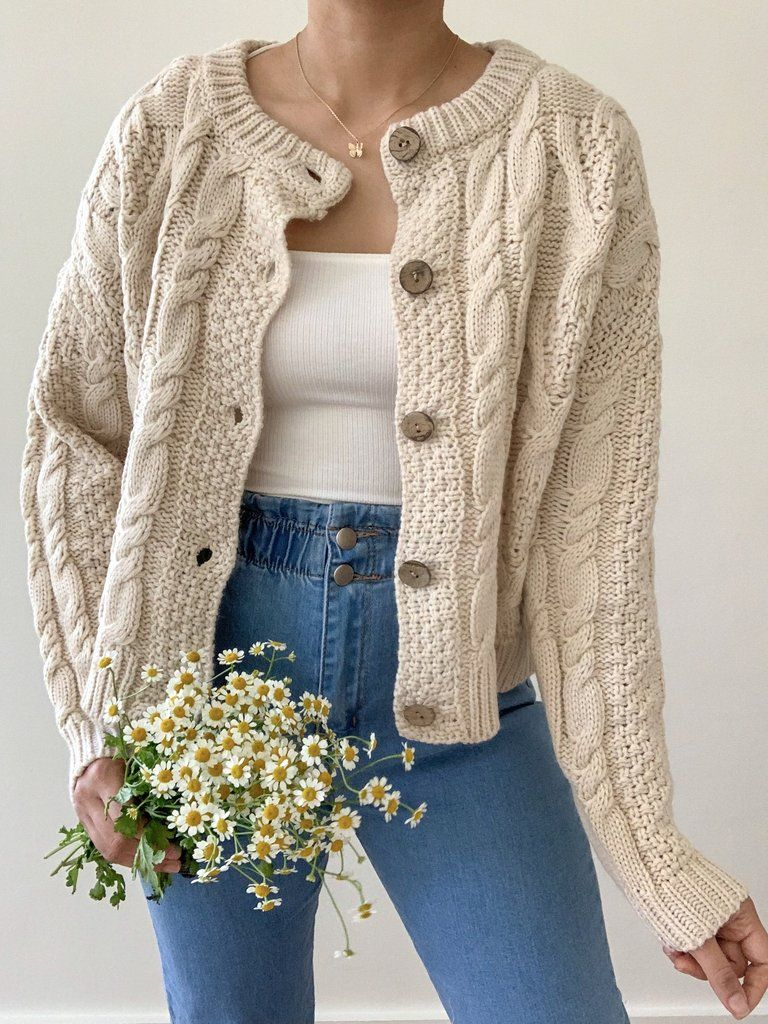 Details: Ivory braided knit button up cardigan. Cardigan