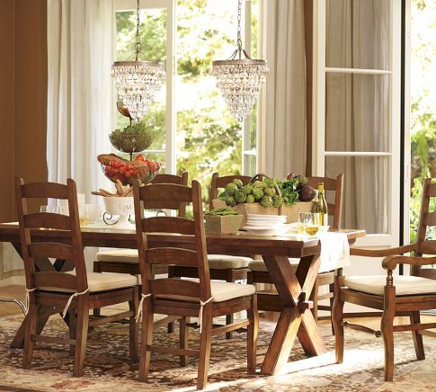 Potterybarn A Rustic Wooden Dining Table And Chairs