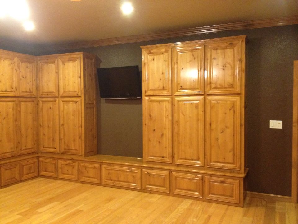 Custom made built in for storage... Knotty Alder with pecan stain