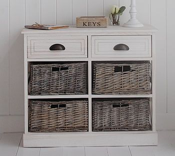 A hallway storage unit with baskets and drawer  Hall furniture from The  White Lighthouse. A hallway storage unit with baskets and drawer  Hall furniture