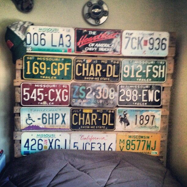 For a young man's room: a pallet headboard with old car licenses tacked to the wood; his mattresses are on pallets, too