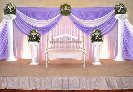 Simple Wedding Stage Decor With Pink And Purple Drapes